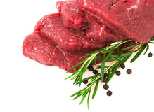 Fresh Raw Meat with pepper and rosemary Royalty Free Stock Photography