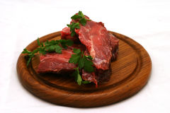 Fresh raw meat on plate. Fresh raw meat on wooden plate Stock Photo