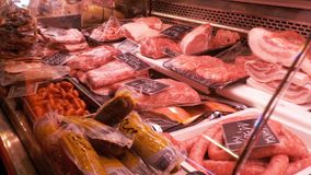 Fresh Raw Meat with Price Tags in trays of Butcher shop in La Boqueria. Barcelona. Spain. Fresh Raw Meat with Price Tags in trays in a counter of market in La stock video footage