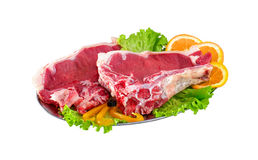 Fresh and raw meat ribs and pork chops isolated on white backgro. Und Royalty Free Stock Image