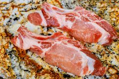 Fresh and raw meat. Ribs and pork chops uncooked , with cuts ready to grill and barbecue. Raw and fresh pork meat Stock Images