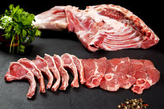 Fresh and raw meat. Ribs and pork chops uncooked, ready to grill and barbecue Royalty Free Stock Photos
