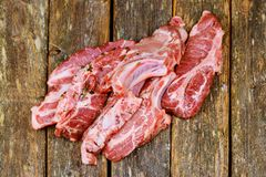 Fresh and raw meat. Ribs and pork chops uncooked, uncut ready grill and barbecue. Fresh and raw meat. Ribs and pork chops uncooked, uncut ready to grill and Royalty Free Stock Image