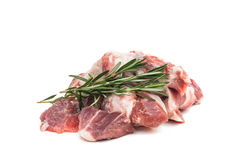 Fresh raw meat with rosemary. Herb isolated on white background Royalty Free Stock Photo