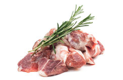 Fresh raw meat with rosemary. Herb isolated on white background Stock Images