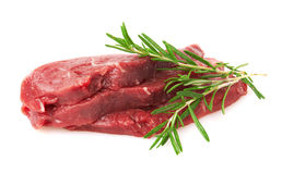 Fresh Raw Meat with rosemary. Isolated on white background Stock Images