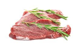 Fresh raw meat with rosemary. On white background Stock Images