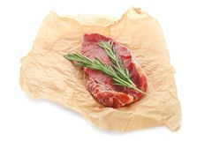 Fresh raw meat with rosemary. On white background Royalty Free Stock Photo