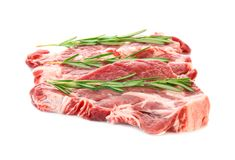 Fresh raw meat with rosemary. On white background Royalty Free Stock Photography