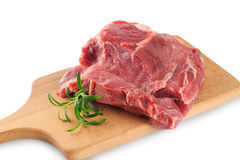 Fresh raw meat and rosemary on a wooden board. White background Royalty Free Stock Photos