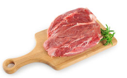 Fresh raw meat and rosemary on a wooden board. White background Stock Photos