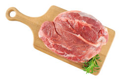Fresh raw meat and rosemary on a wooden board. White background Royalty Free Stock Image