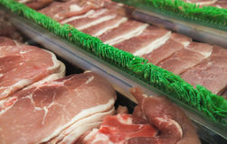 Fresh raw meat. Rows of fresh raw meat on market Stock Images