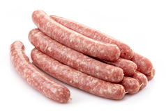 Fresh raw meat sausages. On white backlground Stock Photos