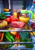 Fresh raw meat on a shelf open refrigerator Royalty Free Stock Photo