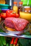 Fresh raw meat on a shelf Royalty Free Stock Photos