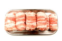 Fresh Raw Meat On Silver Platter. Row of fresh raw meat on a rectangular silver platter Royalty Free Stock Image