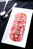 Fresh and raw meat slice. On plate Royalty Free Stock Images