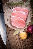 Fresh raw meat sliced. Fresh raw pork sliced on a wooden table Stock Photo