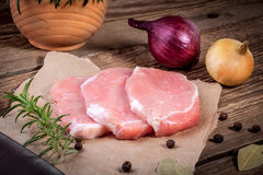 Fresh raw meat sliced. Fresh raw pork sliced on a wooden table Royalty Free Stock Photography