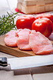 Fresh raw meat sliced. Fresh raw pork sliced on a wooden table Stock Image