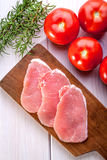 Fresh raw meat sliced. Fresh raw pork sliced on a wooden table Royalty Free Stock Photos
