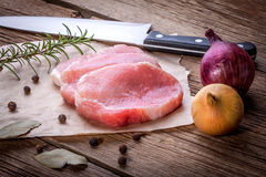 Fresh raw meat sliced. Fresh raw meat sliced on a wooden chopping board Stock Photo