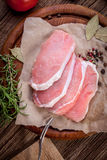 Fresh raw meat sliced. Fresh raw meat sliced on a wooden chopping board Stock Photos