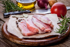 Fresh raw meat sliced. Fresh raw meat sliced on a wooden chopping board Stock Photography