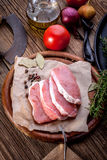 Fresh raw meat sliced. Fresh raw meat sliced on a wooden chopping board Royalty Free Stock Photography