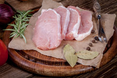 Fresh raw meat sliced. Fresh raw meat sliced on a wooden chopping board Royalty Free Stock Photos