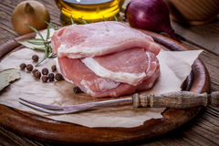 Fresh raw meat sliced. Fresh raw meat sliced on a wooden chopping board Royalty Free Stock Photo