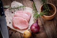 Fresh raw meat sliced. Fresh raw meat sliced on a wooden chopping board Stock Image