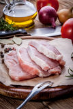 Fresh raw meat sliced. Fresh raw meat sliced on a wooden chopping board Royalty Free Stock Images