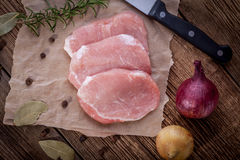 Fresh raw meat sliced. Fresh raw meat sliced on a wooden chopping board Royalty Free Stock Image