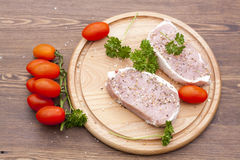 Fresh Raw Meat with spaces, herbs and vegetables. Fresh Raw Steak Meat with spaces, herbs and vegetables, selective focus Stock Images