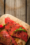 Fresh raw meat. Spices, chilli and garlic Royalty Free Stock Photos