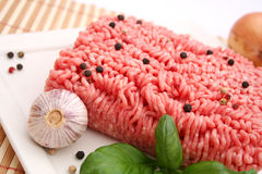 Fresh raw meat. With spices on a plate Stock Photos