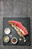 Fresh raw meat and spices. On slate plate Stock Photo