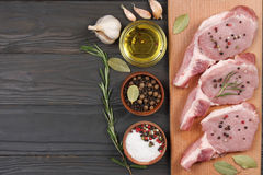 Fresh raw meat with spices on wooden table. top view with copy space. Fresh raw meat with spices on wooden background. top view with copy space Stock Photo