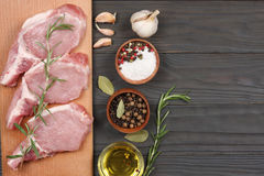 Fresh raw meat with spices on wooden table. top view with copy space. Fresh raw meat with spices on wooden background. top view with copy space Stock Photos