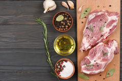 Fresh raw meat with spices on wooden table. top view with copy space. Fresh raw meat with spices on wooden background. top view with copy space Royalty Free Stock Photography
