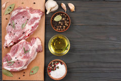 Fresh raw meat with spices on wooden table. top view with copy space. Fresh raw meat with spices on wooden background. top view with copy space Stock Images