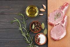 Fresh raw meat with spices on wooden table. top view with copy space. Fresh raw meat with spices on wooden background. top view with copy space Stock Image