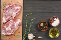 Fresh raw meat with spices on wooden table. top view with copy space. Fresh raw meat with spices on wooden background. top view with copy space Royalty Free Stock Photo
