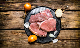 Fresh raw meat on a stand and onion . On the wooden background. Top view Stock Photography