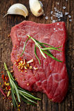 Fresh raw meat for steak. On wooden cutting board Royalty Free Stock Photography