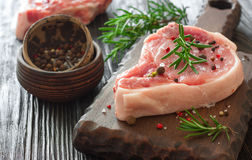 Fresh raw meat for steak on wooden cutting board. Fresh raw meat for steak with spices on wooden cutting board Stock Image