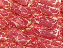 Fresh raw meat steaks at the market. Fresh raw meat steaks closeup for sale at the market, food background Stock Images