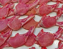Fresh raw meat steaks at the market. Fresh raw meat steaks closeup for sale at the market, food background Stock Image